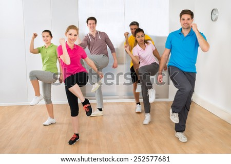 Group Of Multiethnic People Dancing In Gym - stock photo