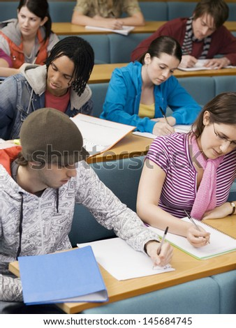 Group of multiethnic students in lecture room - stock photo