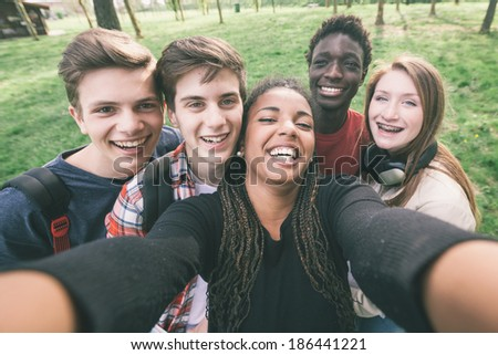 Group of Multiethnic Teenagers Taking a Selfie - stock photo