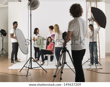 Group of multiethnic young people in studio during photo session - stock photo