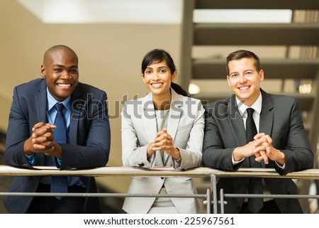 group of multiracial business people standing by stairway - stock photo