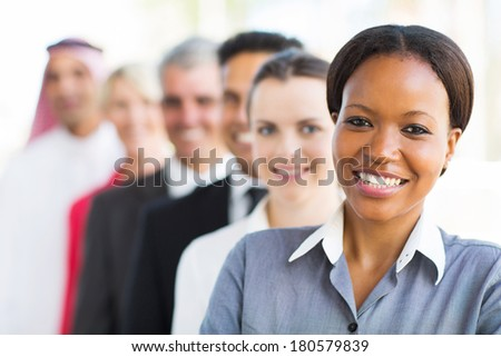 group of multiracial business team standing in a row - stock photo