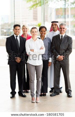 group of multiracial businesspeople standing together in office - stock photo