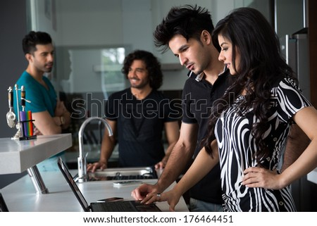 group of multiracial friends hanging out together - stock photo