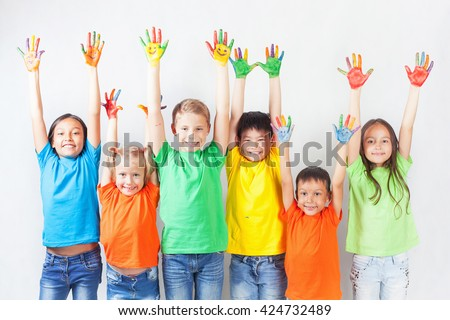 Group of multiracial funny children. Funny kids hands up. - stock photo