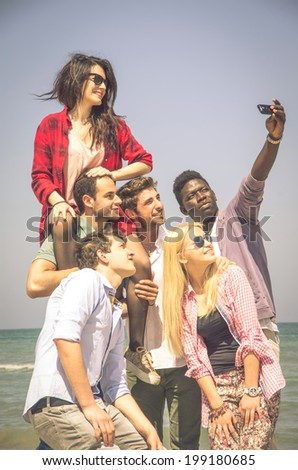 Group of multiracial happy friends taking a selfie - stock photo