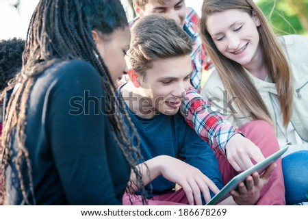 Group of Multiracial Teenage Friends with Tablet PC  - stock - stock photo