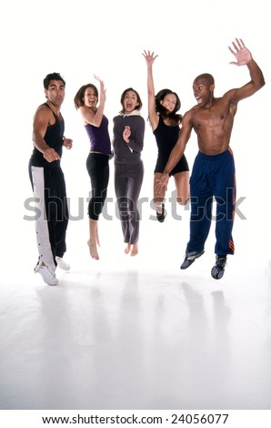 Group of multiracial young adults jumping with joy in fitness wear. All logos removed. - stock photo