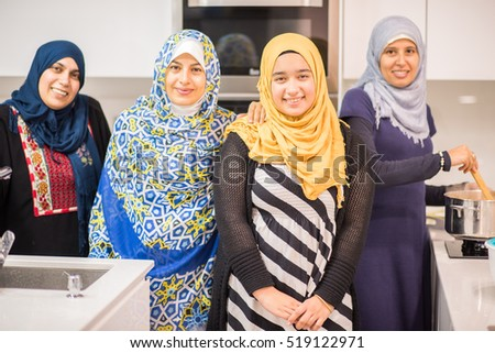 Group of Muslim women in kitchen making food