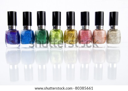 Group of nail polishes of different colors on white background - stock photo