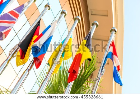 group of national flags on flagpoles