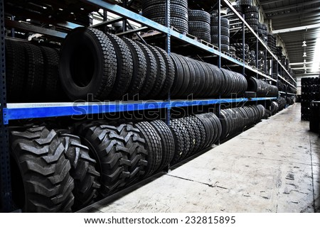 Group of new tires for sale at a tire store - stock photo