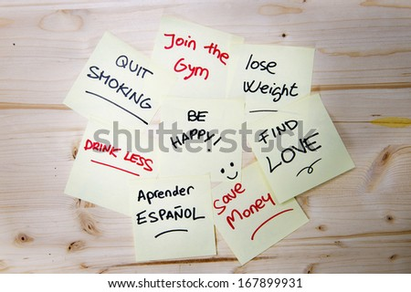 Group of New year Resolutions written on Post it Notes  - stock photo