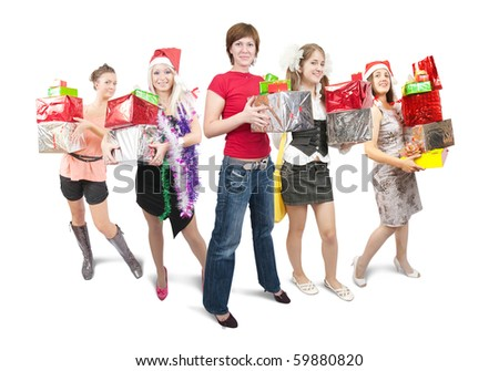 Group of nice girls holding coloured christmas gifts over white - stock photo