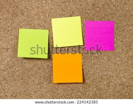 Group of Notes in blank as copy space in different colors such as pink, yellow, orange and green on message cork board - stock photo