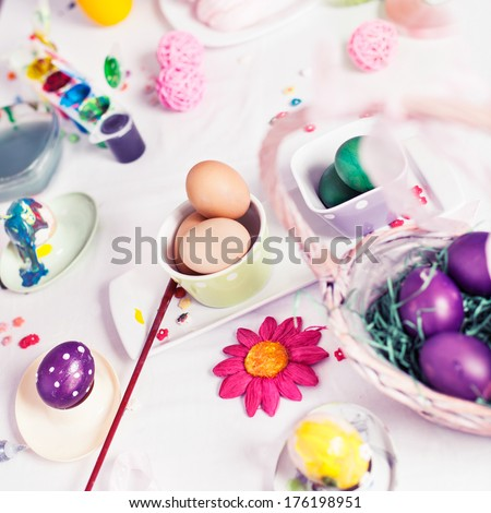 Group of objects on a table for decorating Easter eggs. - stock photo