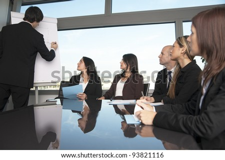 Group of office workers in a boardroom presentation - stock photo