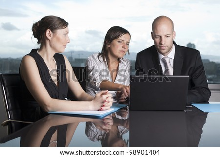 Group of office workers in a powerpoint presentation on laptop