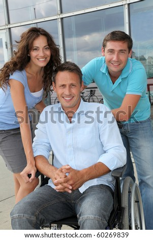 Group of office workers with handicapped person - stock photo