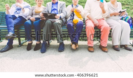 Group of old people making activities outdoor - stock photo