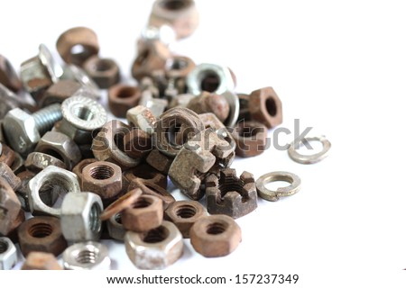 group of old rusty nuts and bolts isolated on white background - stock photo