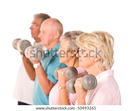 Group of older mature people lifting weights in the gym - stock photo