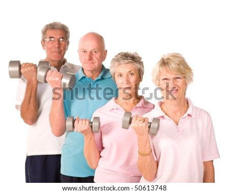 Group of older senior people lifting weights in the gym - stock photo
