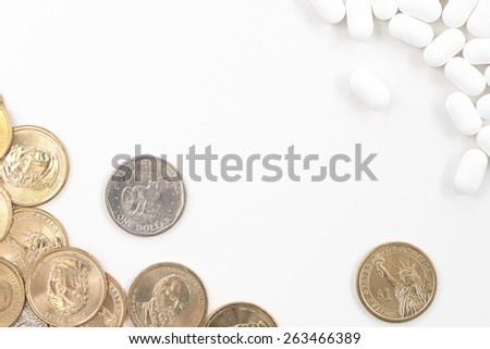 Group of one dollar coins with white pill copyspace white background concept of medical cost - stock photo