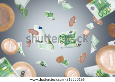 Group of one hundred euro banknotes and coins flying on dark background. - stock photo