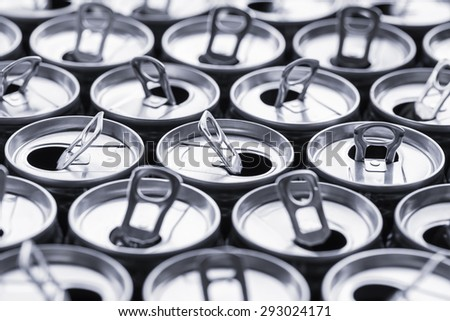group of open cans background, view of the cans top. - stock photo