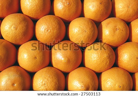 Group of oranges ready for juicing; can be used as background