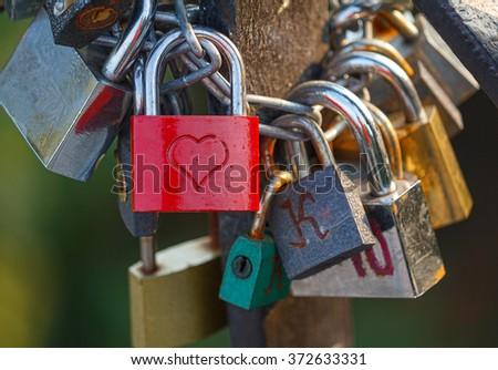 Group of padlocks on the bridge of lovers - stock photo