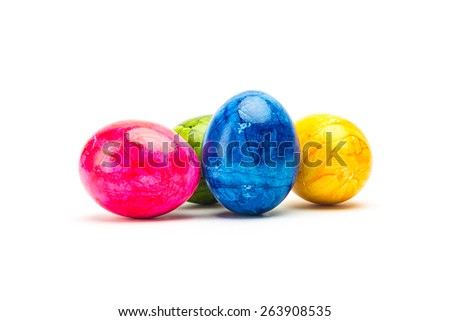 group of painted easter eggs in colorful colors on white background