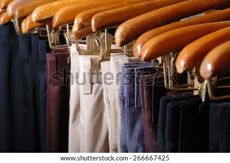 Group of Pants at retail shop - stock photo