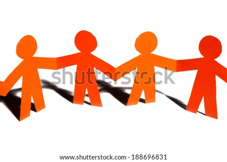 Group of paper doll holding hands. Teamwork concept paper craft. Orange dolls on white background