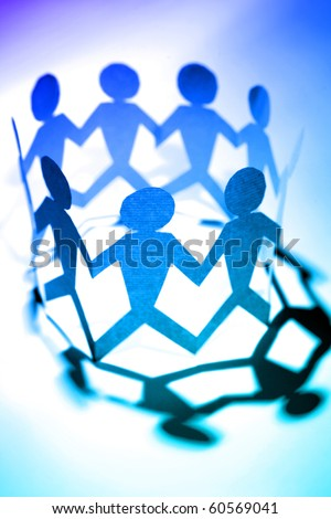 Group of paper doll people holding hands - stock photo
