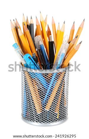 Group of pens and wooden pencils in metal vase isolated on white background - stock photo