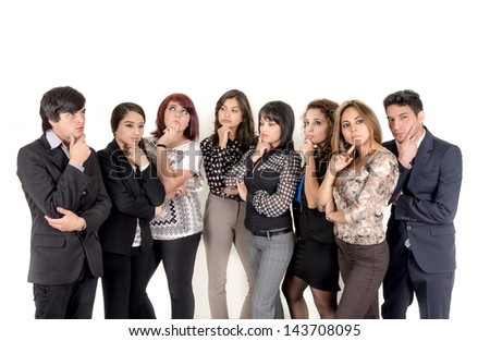 Group of pensive hispanic business people - stock photo