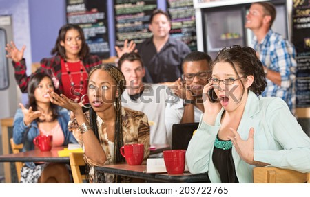Group of people annoyed with obnoxious person on phone - stock photo
