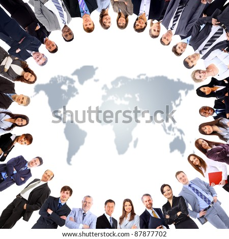 Group of people around a world map - stock photo
