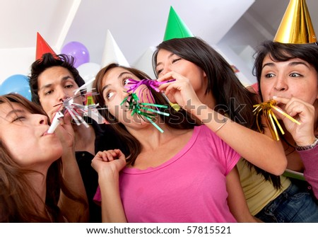 Group of people at a birthday party having fun - stock photo