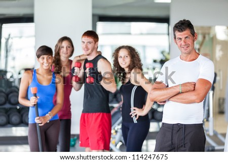 Group of People at Gym with Instructor - stock photo