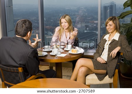 Group of People at the Cofe Table. Short Depth of Focus (On Women's Faces). - stock photo