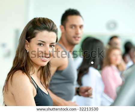group of people at the gym doing cardio exercises - stock photo
