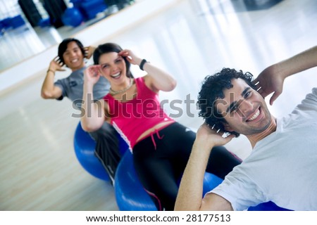 group of people at the gym doing sit-ups - stock photo