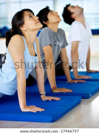 group of people at the gym doing yoga exercises - stock photo