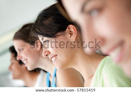 group of people at the gym in a row and smiling - stock photo