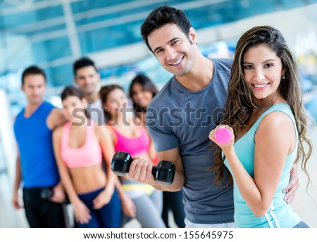 Group of people at the gym looking very happy  - stock photo