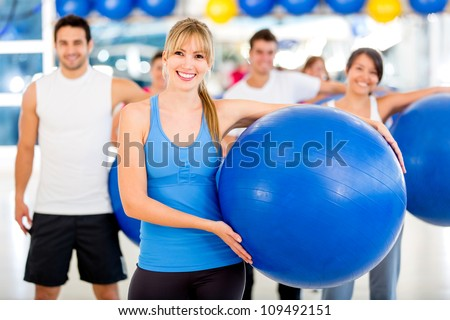 Group of people at the gym on a Pilates class - stock photo