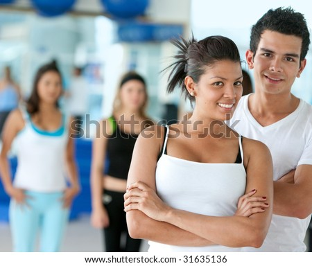 group of people at the gym smiling - stock photo